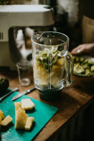 photo of fruits on blender